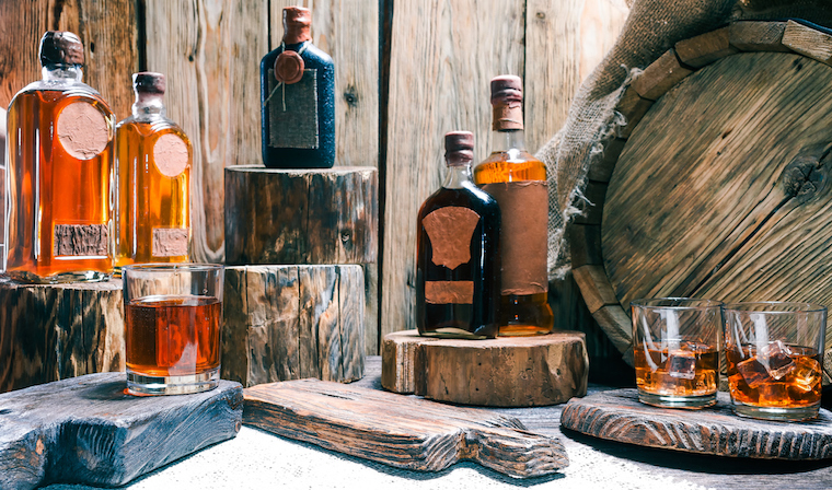 Australian whiskey bottles and glasses full of whisky on wooden boards